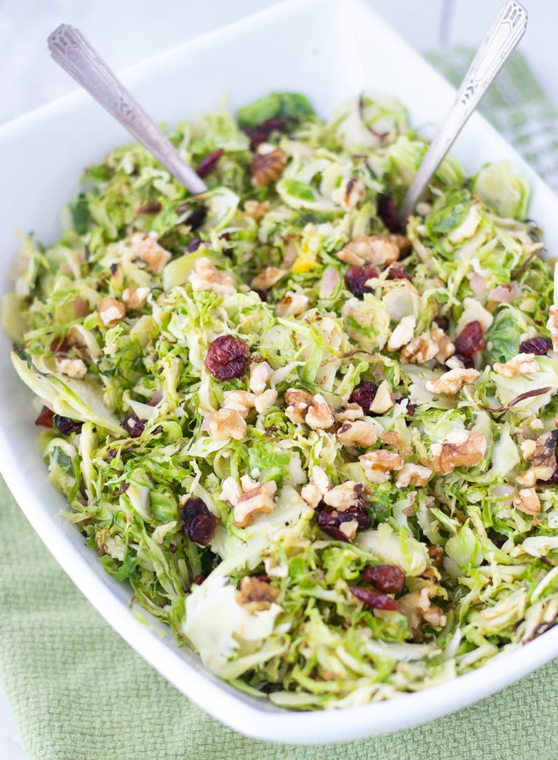 Cranberry Orange Brussels Sprouts Slaw is an easy and healthy side dish recipe to enjoy with your next dinner. Brussels sprouts salad is shaved brussels sprouts tossed with cranberries and walnuts in an orange dressing. #cranberry #brussselssprouts #shavedbrusselssprouts #walnuts #cranberryorange #paleorecipe #whole30 #healthysidedish