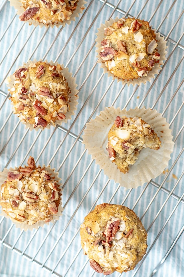 Vegan Nutty Banana Muffins that are gluten free and dairy free are easy to make and have a crunchy pecan coconut topping everyone will love!