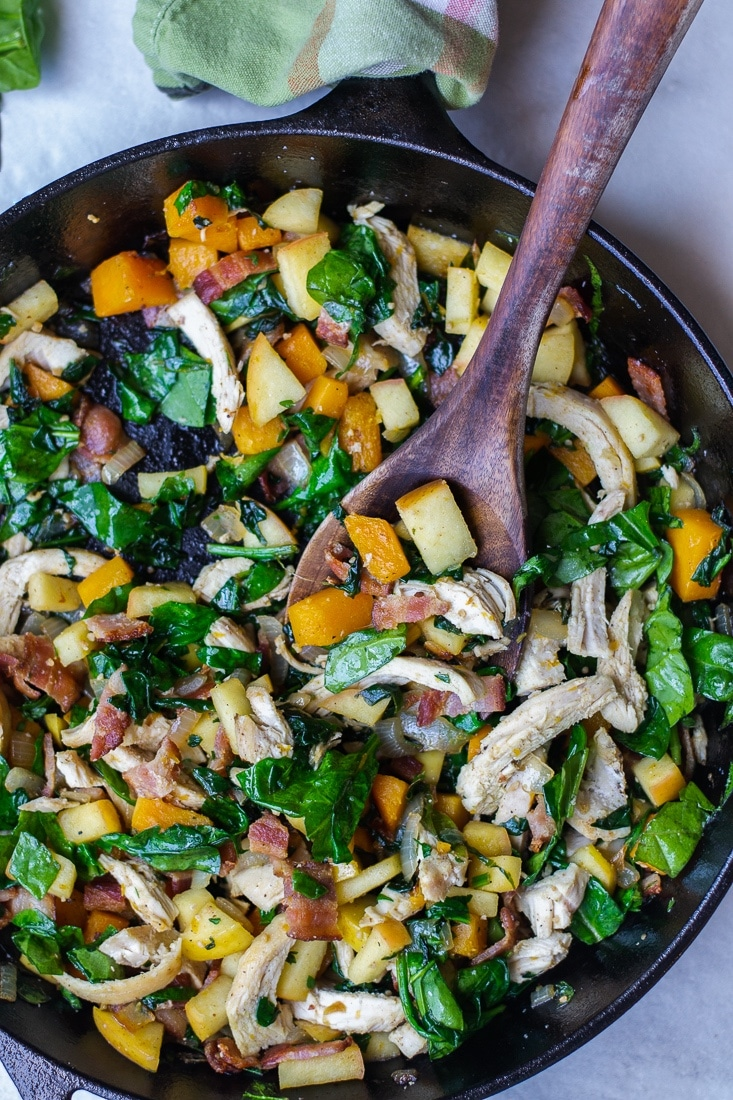 A healthy, egg free skillet breakfast that is paleo, Whole30 and high protein. This Harvest Skillet recipe is filled with bacon, butternut squash, apples, spinach and tons of leftover turkey! Great for Thanksgiving leftovers!