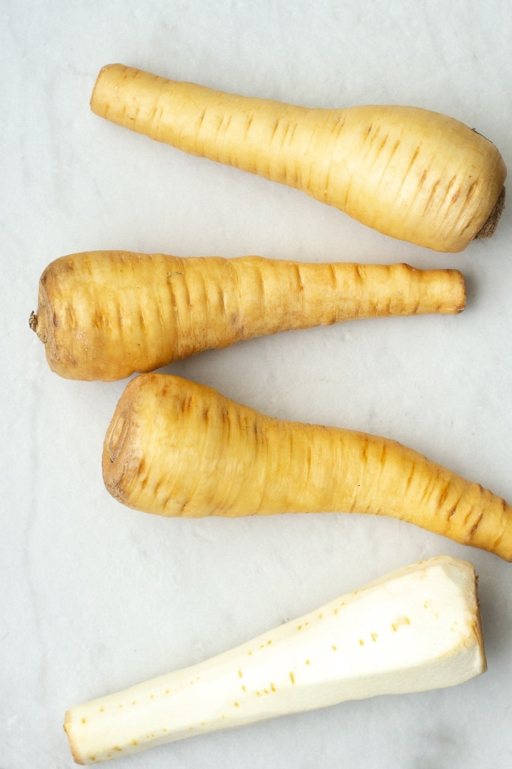 Garlic and sage whipped parsnips are a creamy and healthy side for all your favorite chicken and steak recipes. This dairy free parsnip puree recipe is paleo and whole30 approved!