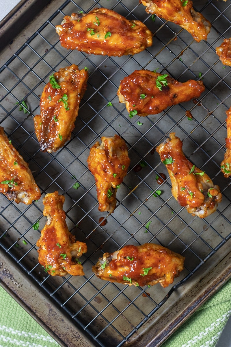 Healthier baked chicken wings are cooked in the oven until crispy and coated with a homemade sweet and spicy honey chipotle barbecue sauce. Bring these to your Super Bowl party and everyone will love them!