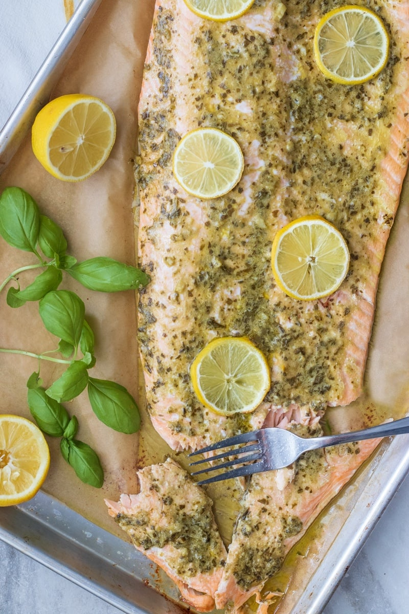 Pesto butter salmon is perfect for weeknight dinners, meal prep and is low carb or keto too. This whole salmon fillet is on the table in just 15 minutes!