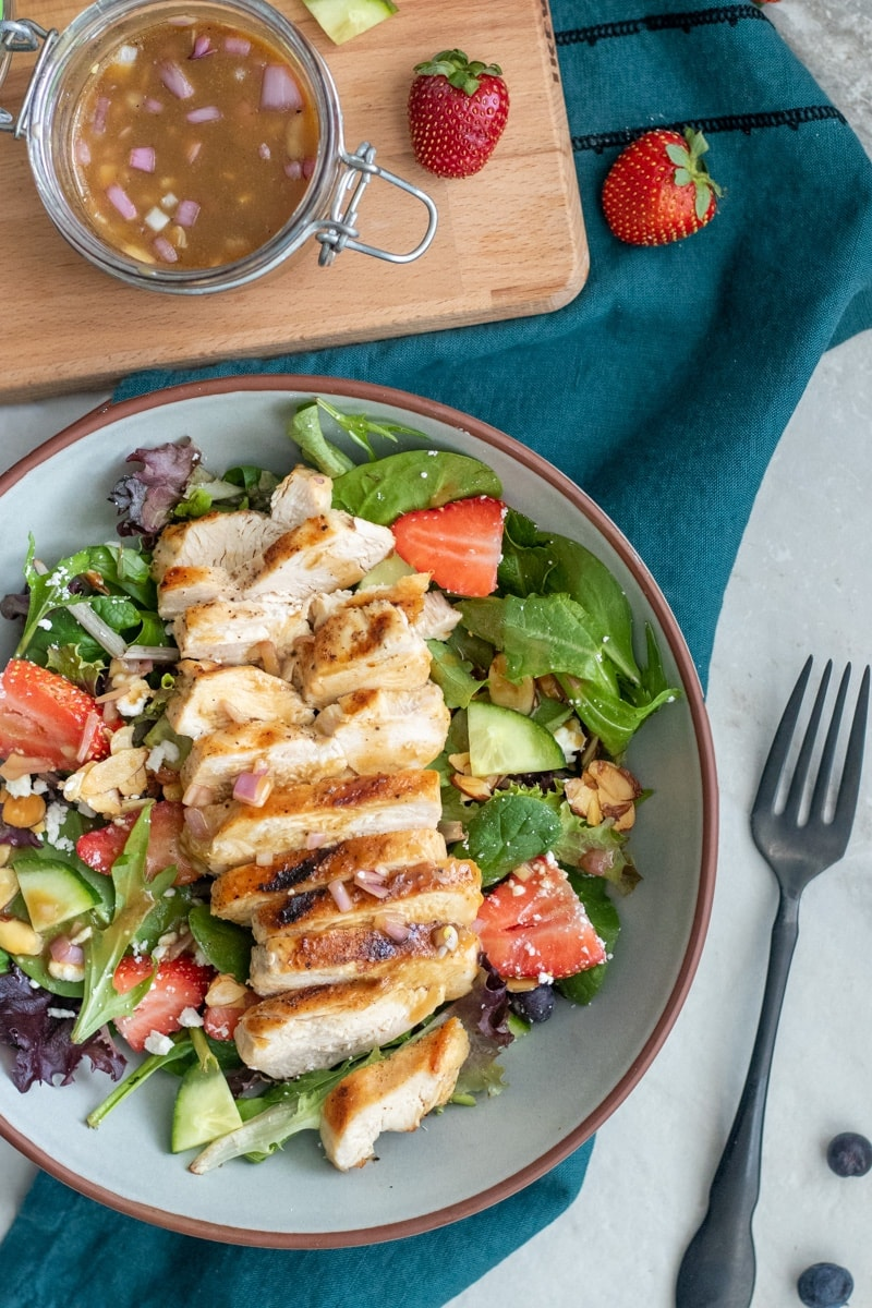Make strawberry salad a meal by topping it with chicken.