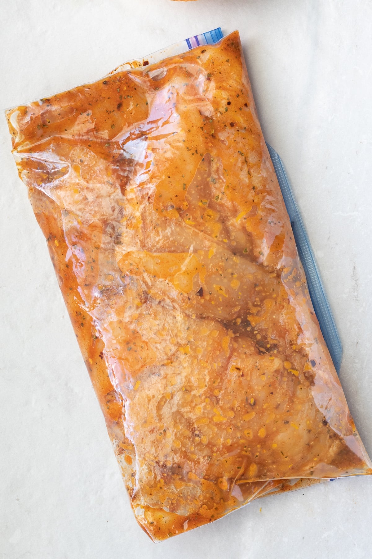 Put the chicken breast in a large zipper bag to marinate.