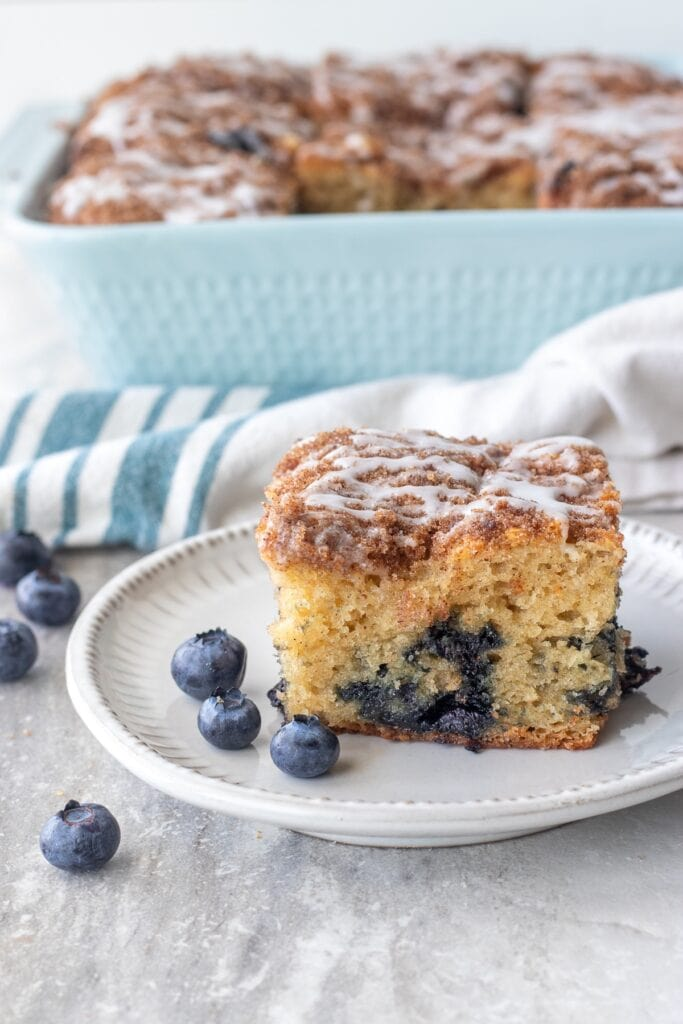 Slice the coffee cake into 9 pieces and serve warm or cool.