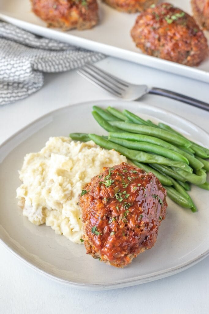 Serve mini meatloaves with mashed potatoes and steamed green beans.