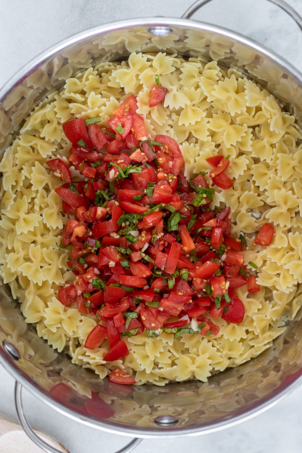 Add bruschetta to the cooked pasta